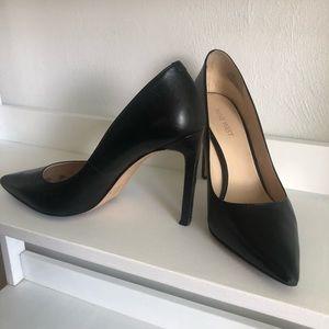 Black pointed toe stilettos